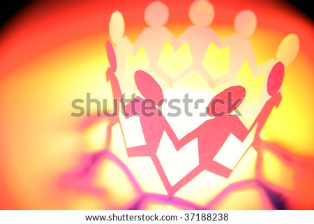 Team holding hands in a circle - stock photo