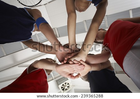 Team in a Huddle - stock photo
