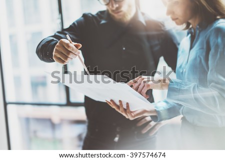 Team job succes.Photo young business managers  working with new startup project in modern office.Analyze document, plans. Holding papers, documents hands. Horizontal, blurred - stock photo