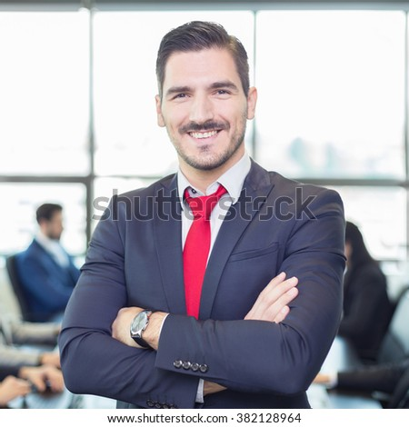 Team leader with coworkers working in office. - stock photo