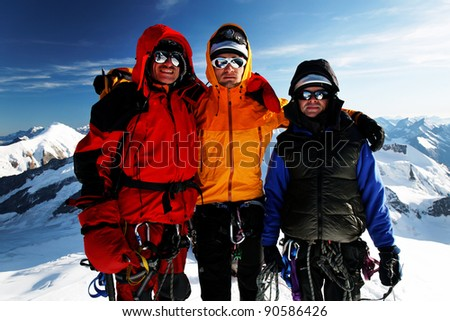 Team of alpinists celebrating on a peak - stock photo