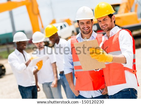 Team of architects working at a construction site  - stock photo