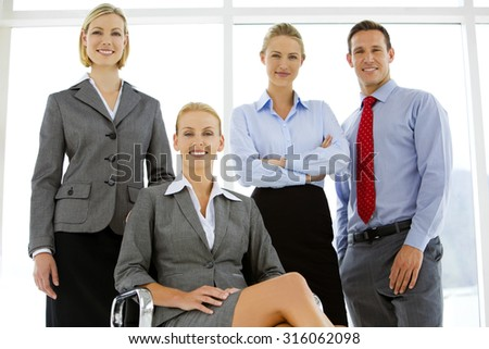 Team of business managers posing for a portrait