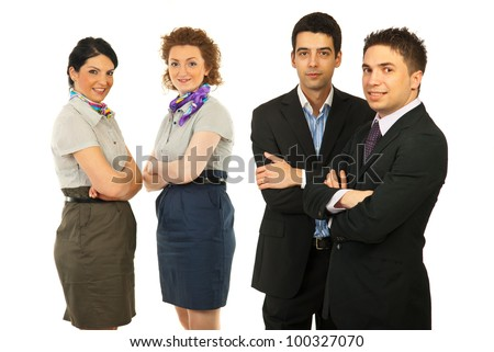 Team of business men in front of camera and business women smiling in background