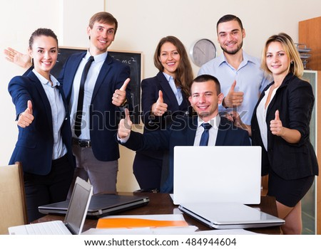 Team of business partners professional posing in office
