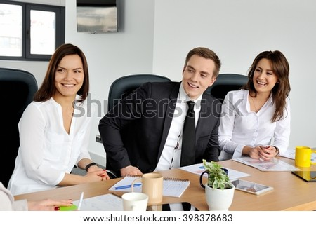 Team of business people having a meeting in an office.