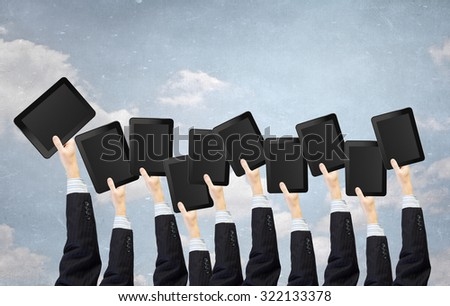 Team of business people holding tablets in hands