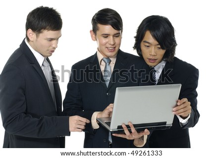 Team of business people looking at laptop computer