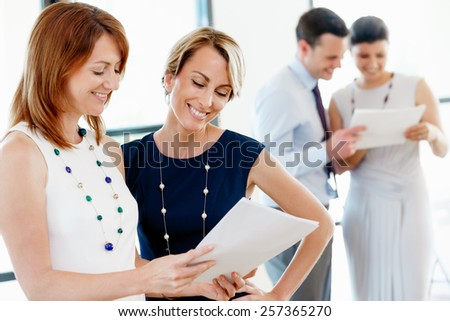 Team of business people standing in office