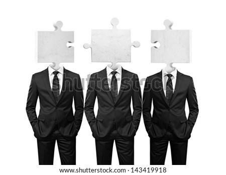 team of businessman with puzzle pieces instead heads on white - stock photo