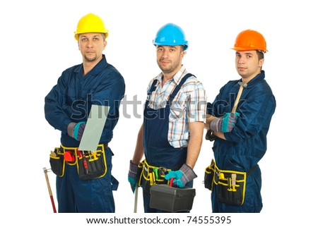 Team of constructor workers in a line holding tools isolated on white background - stock photo