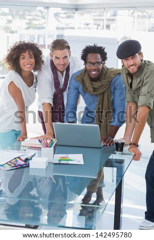 Team of creative designers smiling at camera - stock photo