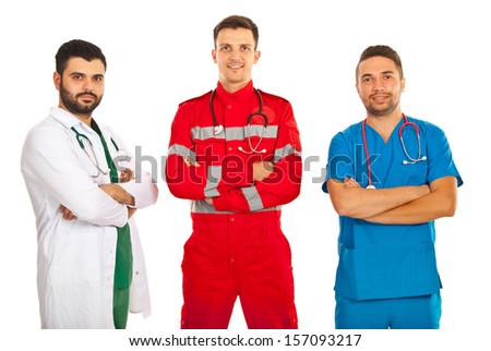 Team of different doctors standing with arms folded isolated on white background