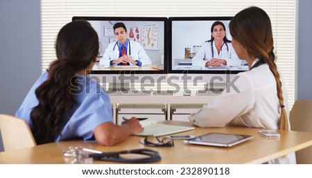 Team of diverse medical doctors having a video conference - stock photo