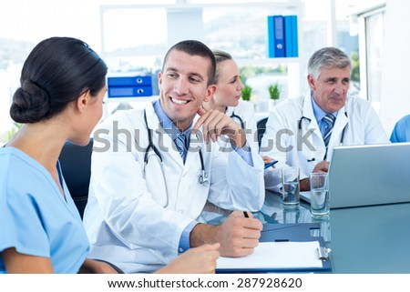 Team of doctors having a meeting in medical office - stock photo