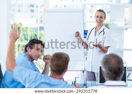 Team of doctors having brainstorming session in the meeting room - stock photo