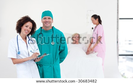 Team of Doctors in a hospital looking after a patient - stock photo