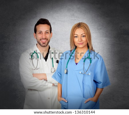 Team of doctors isolated on a over irregular gray background - stock photo