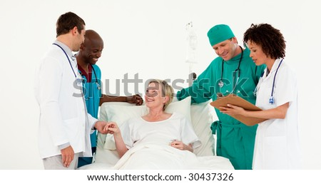 Team of Doctors looking after a patient - stock photo