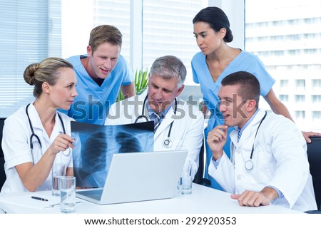 Team Doctors Working On Laptop Analyzing Stock Photo 292920353 ...