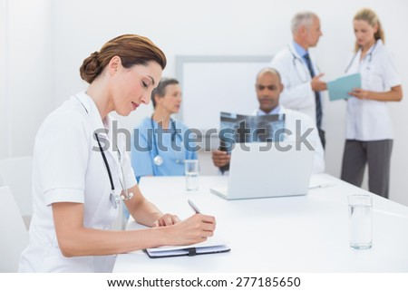 Team of doctors working together in medical office - stock photo