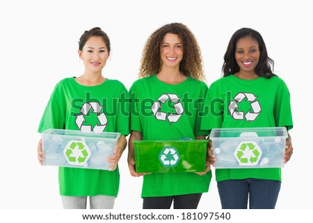 Team of environmental activists holding boxes smiling at camera on white background - stock photo