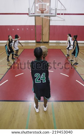 Team of female basketball players on a basketball court - stock photo