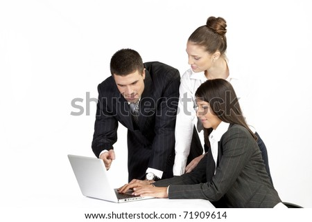 team of four business people having a meeting working on laptop and having conversation. isolated on white - stock photo