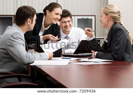 Team of four business people working together