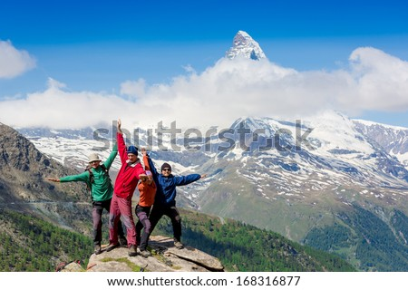 Team of hikers on the rocky summit
