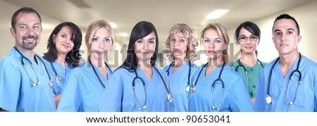 Team of medical professionals in hospital - stock photo