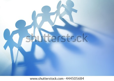 Team of paper doll people. Blue tone. - stock photo