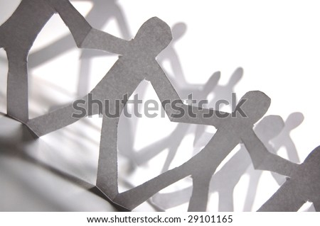 team of paper people having a party - stock photo