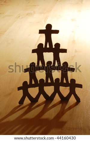 team of paper people showing concept of teamwork - stock photo