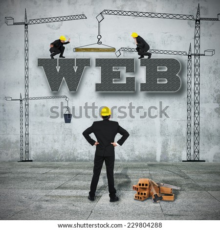 team of people building the web word - stock photo