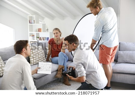 Team of photographers on a shooting day in studio