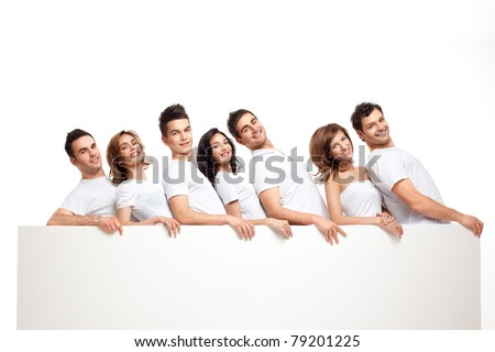 team of playful smiling people holding banner - stock photo