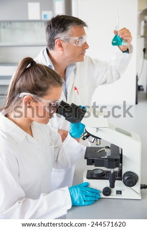 Team of scientists at work at the laboratory - stock photo