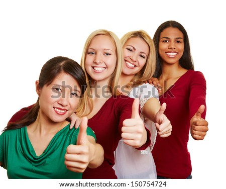 Team of smiling multicultural women holding their thumbs up - stock photo