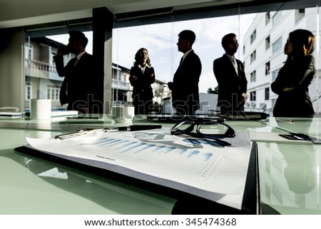 team of successful business people after meeting - stock photo