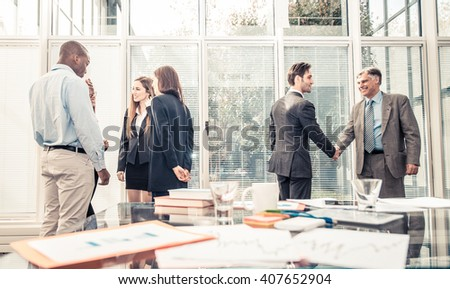Team of successful business people - Business team brainstorming in the office - stock photo