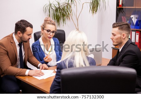 Team of successful business people in office talking and working on new projects
