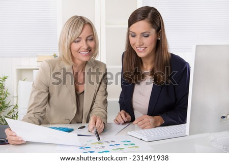 Team of successful businesswoman in the office working in leading positions. - stock photo