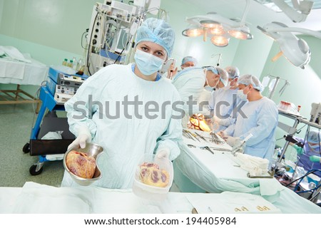 Team of surgeon perform heart transplantation operation on a patient at cardiac surgery clinic