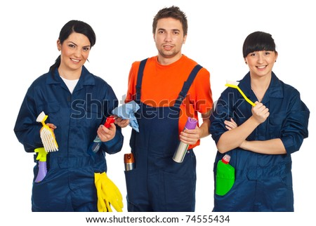 Team of three cleaning workers holding cleaning products isolated on white background - stock photo