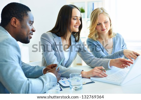Team of three considering optimal business solutions - stock photo