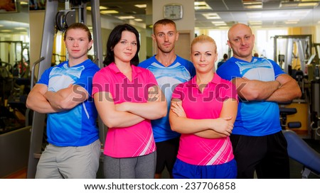 team of trainers at the gym - stock photo
