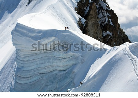 Team of two alpinists on Rochefort Ridge, France - stock photo