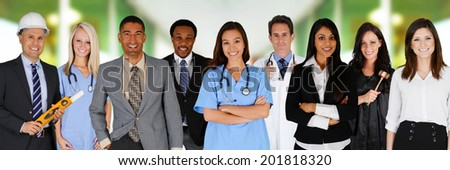 Team of workers together in an office setting - stock photo