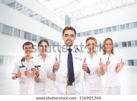 Team of young and smart medical workers - stock photo